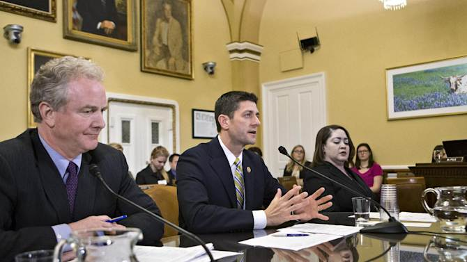 House Budget Committee Chairman Paul Ryan, R-Wis., appears before the House Rules Committee to testify on his party's budget proposal, at the Capitol in Washington, Monday, March 18, 2013. He is joined at left by Rep. Chris Van Hollen, D-Md., the ranking member on the House Budget Committee.  (AP Photo/J. Scott Applewhite)