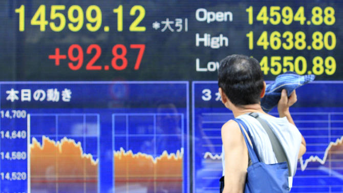 Asian stocks mixed ahead of Bernanke's testimony