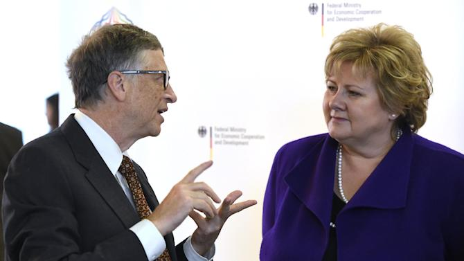 US business magnate Bill Gates (L) and Prime Minister of Norway Erna Solberg talk during a two-day pledging conference of the Global Alliance for Vaccines and Immunisation (GAVI) organisation in Berlin, on January 27, 2015