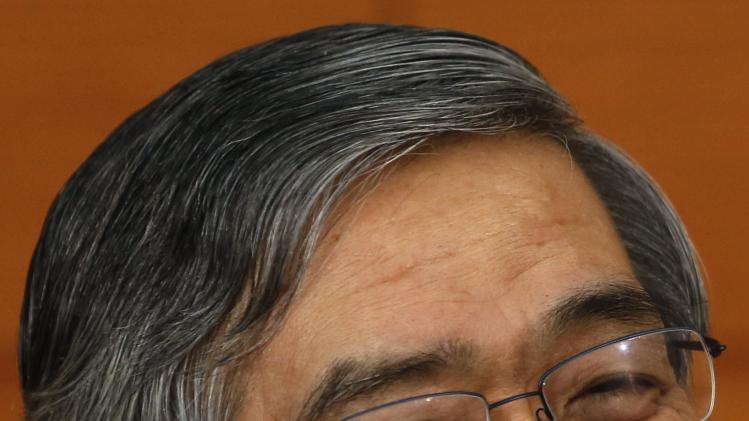 Bank of Japan Governor Haruhiko Kuroda smiles as he speaks during a news conference at the BOJ headquarters in Tokyo