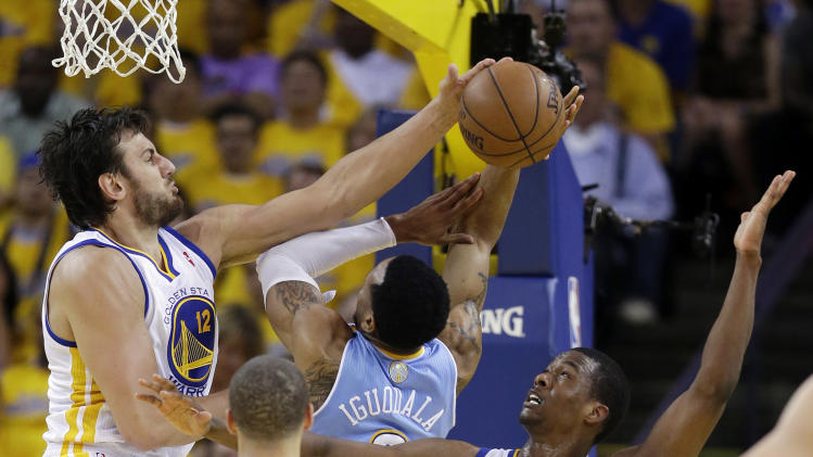 Golden State Warriors' Andrew Bogut, top left, blocks a shot by Denver Nuggets' Andre Iguodala, center, as Warriors' Harrison Barnes, right, watches during the first half of Game 6 in a first-round NBA basketball playoff series in Oakland, Calif., Thursday, May 2, 2013. (AP Photo/Marcio Jose Sanchez)