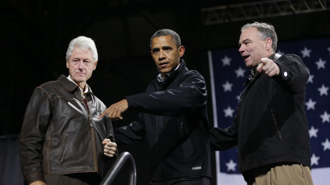 President Barack Obama, center, is joined by former President Bill Clinton, left, and Democratic candidate for the U.S. Senate from Virginia, former Gov. Tim Kaine, right, on stage at a rally at Jiffy Lube Live arena, late Saturday night, Nov. 3, 2012, in Bristow, Va. (AP Photo/Pablo Martinez Monsivais)
