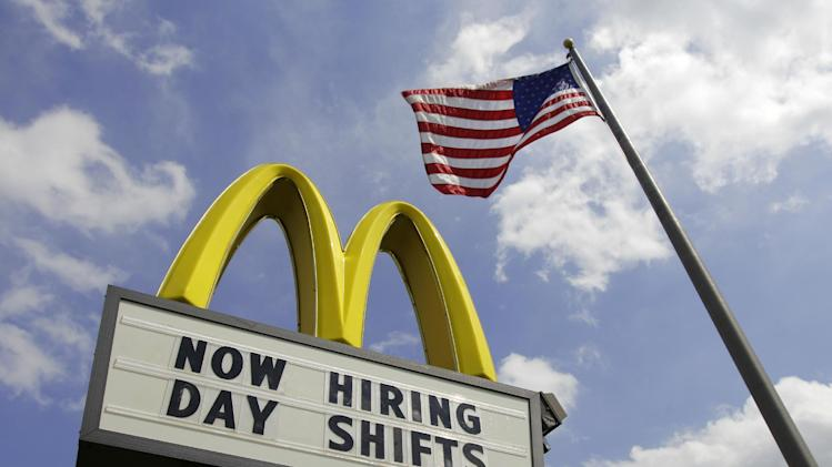 This May 2, 2012, photo shows a sign advertising job openings outside a McDonalds restaurant in Chesterland, Ohio. The number of people seeking unemployment benefits fell last week by the most in more than three months, the Labor Department reported Thursday, May 3. The figure was a hopeful sign one day before the government releases the April jobs report. (AP Photo/Amy Sancetta)