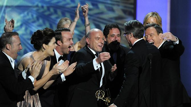 "FILE - This Sept. 22, 2013 file photo shows the cast of ""Breaking Bad,"" from left, Bob Odenkirk, Betsy Brandt, Aaron Paul, Dean Norris and Bryan Cranston, right, congratulating creator Vince Gilligan, second right, after he accepted the award for outstanding drama series at the 65th Primetime Emmy Awards in Los Angeles. The Nielsen company said that on the same night that ""Breaking Bad"" won an Emmy Award for best drama, the penultimate episode of that AMC series set a viewership record. An estimated 6.6 million people watched ""Breaking Bad"" on Sunday, which was airing the same time the cast got its award. (Photo by Chris Pizzello/Invision/AP, File)"