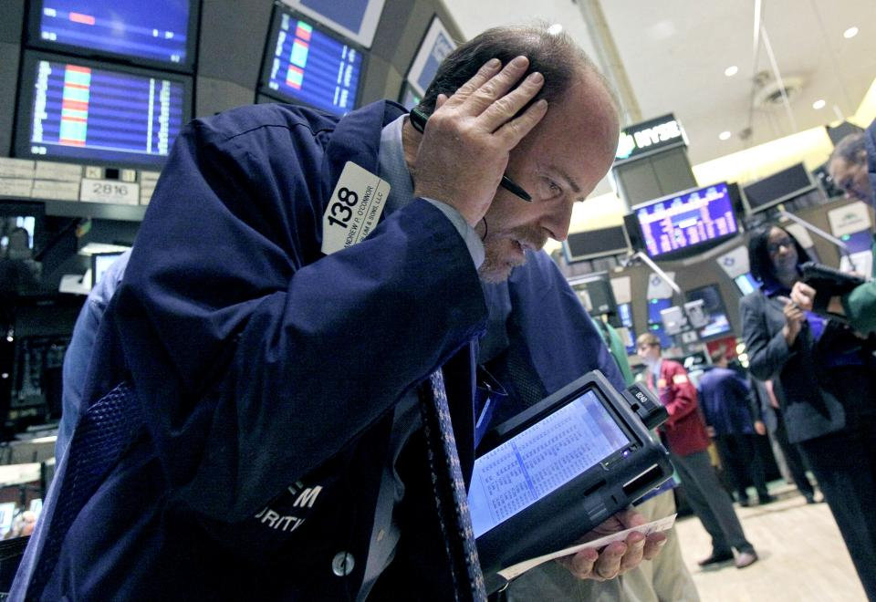 Trader Andrew O'Connor works on the floor of the New York Stock Exchange Tuesday, Oct. 9, 2012. Another dire prediction about global economic growth is sending stocks lower on Wall Street in early trading. (AP Photo/Richard Drew)
