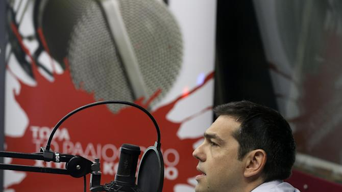 Greece's Prime Minister Alexis Tsipras gives an interview to the radio station ''Sto Kokkino 1055'' in Athens, Wednesday, July 29, 2015.  Greece's parliament has already approved two batches of reforms, drastically increasing sales tax on key consumer goods, and reforming the banking and judiciary systems. But that caused a rift within Tsipras' party, and about a quarter of his lawmakers refused to back the reforms, which were passed with the help of pro-European opposition parties. (AP Photo/Thanassis Stavrakis)