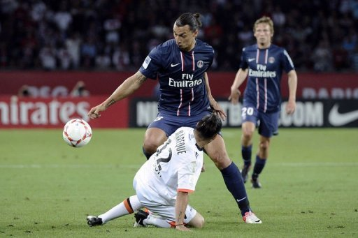 Paris Saint-Germain's forward Zlatan Ibrahimovic (top) fights for the ball with Lorient's defender Lucas Mareque
