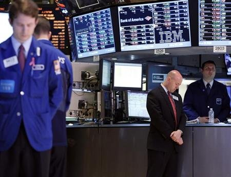 Traders on the floor at the New York Stock Exchange join the moment of silence in honor of the Boston marathon victims, April 22, 2013. REUTERS/Brendan McDermid
