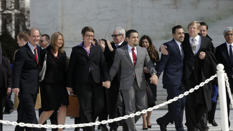 From left, attorney David Boies, plaintiffs, Sandy Stier, with partner Kris Perry, from Berkeley, Calif., Jeff Zarrillo, with partner Paul Katami from Burbank, Calif., and their attorney Theodore Olson leave the Supreme Court in Washington, Tuesday, March 26, 2013, after the heard arguments on California's voter approved ban on same-sex marriage, Proposition 8. The Supreme Court waded into the fight over same-sex marriage Tuesday, at a time when public opinion is shifting rapidly in favor of permitting gay and lesbian couples to wed, but 40 states don't allow it. (AP Photo/Pablo Martinez Monsivais)