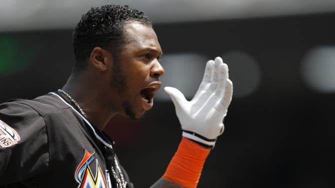 Miami Marlins' Hanley Ramirez argues with home plate umpire Greg Gibson after getting called out on strikes in the first inning of a baseball game against the Washington Nationals at Nationals Park, in Washington, on Saturday, April 21, 2012. (AP Photo/Jacquelyn Martin)