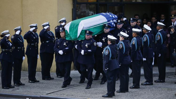 NYPD officers carry the casket of Ranasinghe after his wake service in New York
