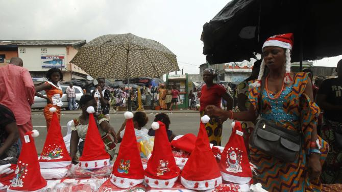 Vendor sells Christmas decorations on a street in Adjame in Abidjan