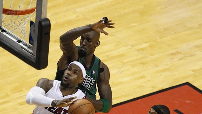 Miami Heat's LeBron James (6) drives to the basket past Boston Celtics' Ray Allen (20), Rajon Rondo (9) and Kevin Garnett, during overtime in Game 2 in their NBA basketball Eastern Conference finals playoffs series, Wednesday, May 30, 2012, in Miami. The Heat defeated the Celtics 115-111. (AP Photo/Wilfredo Lee)