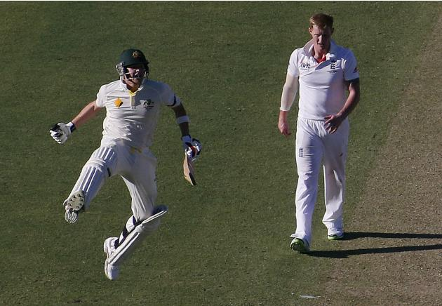 Australia's Smith celebrates reaching his century as England's Stokes looks on during the first day of the third Ashes test cricket match in Perth