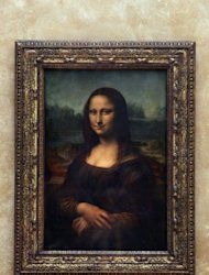 The Mona Lisa, painted by Leonardo da Vinci, hanging in the Louvre museum in Paris. Archaeologists on Tuesday unearthed a skeleton in a rare state of preservation in Florence in a crucial step towards unravelling the mystery of the identity of the woman with the most enigmatic smile in the world