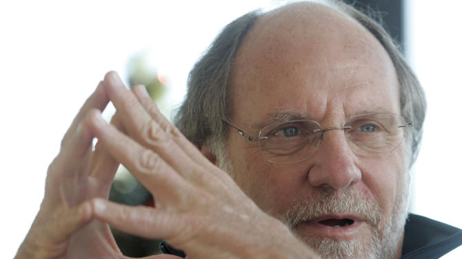 FILE - In this Jan. 9, 2011 file photo, former New Jersey Gov. Jon S. Corzine reflects on his four year term in office during an interview with The Associated Press at his home in Hoboken, N.J. MF Global Holdings Ltd. has been suspended from conducting new business with the New York Fed amid reports that the company plans to file for bankruptcy. (AP Photo/Rich Schultz, File)