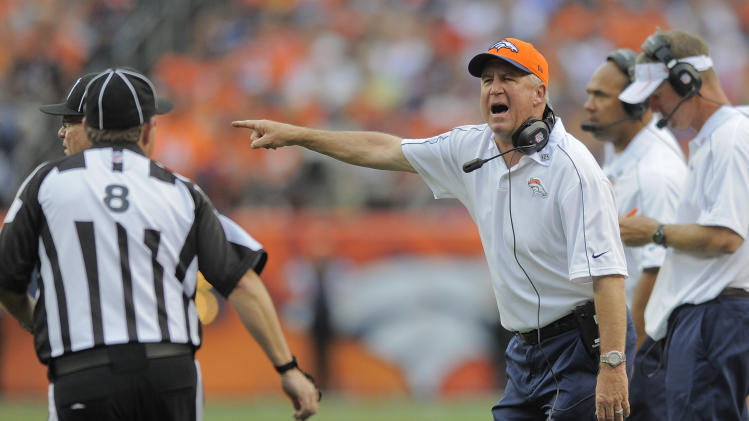 Denver Broncos head coach John Fox, right, shouts to the referee in the fourth quarter of an NFL football game against the Houston Texans, Sunday, Sept. 23, 2012, in Denver. (AP Photo/Jack Dempsey)