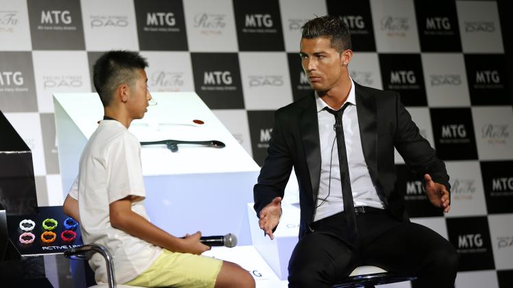 Real Madrid's soccer player Ronaldo talks with a Japanese fan during a promotional event in Tokyo