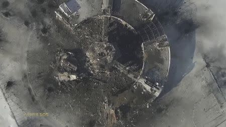 Still image taken from handout aerial footage shot by a drone shows a multi-storey control tower of the Sergey Prokofiev International Airport damaged...