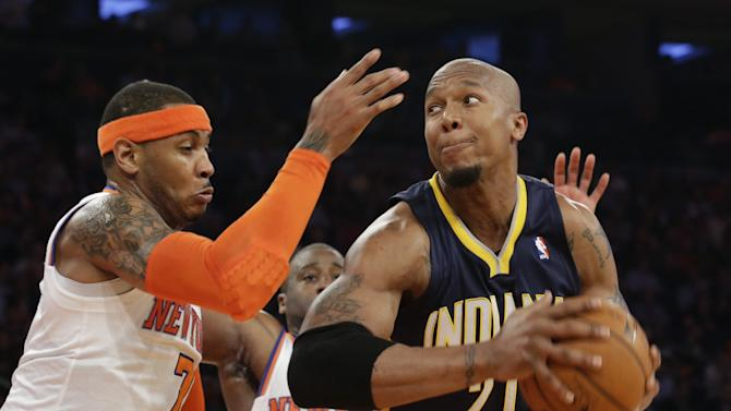 Indiana Pacers' David West, right, drives against New York Knicks' Carmelo Anthony in the first half of Game 5 of an Eastern Conference semifinal in the NBA basketball playoffs, at Madison Square Garden in New York, Thursday, May 16, 2013. (AP Photo/Julio Cortez)