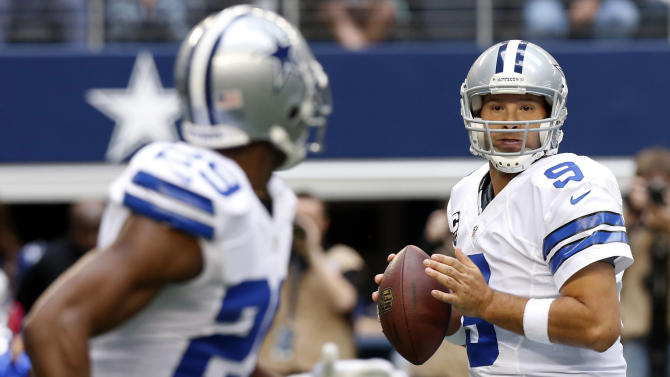 Dallas Cowboys quarterback Tony Romo (9) looks to pass the ball to running back DeMarco Murray (29) during the first half of an NFL football game against the New Orleans Saint,s Sunday, Dec. 23, 2012, in Arlington, Texas. (AP Photo/Sharon Ellman)