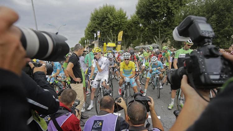 Photographers take pictures of Italy's Vincenzo Nibali, wearing the overall leader's yellow jersey, and France's Romain Bardet, wearing the best young rider's white jersey, prior to the start of the sixteenth stage of the Tour de France cycling race over 237.5 kilometers (147.6 miles) with start in Carcassonne and finish in Bagneres-de-Luchon, France, Tuesday, July 22, 2014. (AP Photo/Laurent Cipriani)