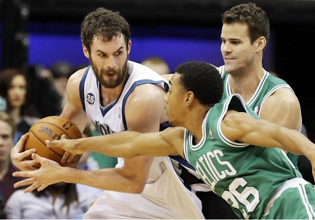 Minnesota Timberwolves' Kevin Love , left, keeps an eye on Boston Celtics' Phil Pressey, right, as Celtics' Kris Humphries, back, comes into the play in the second half of an NBA basketball game on Sa