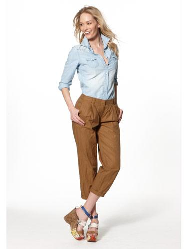 Over-the-top platform wedges are anchored in reality by neutral cropped trousers.