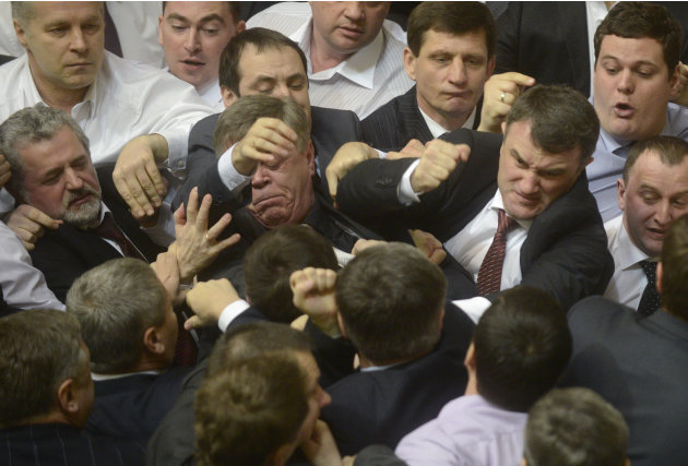 Ukrainian deputies scuffle during a session in the national Parliament in Kiev