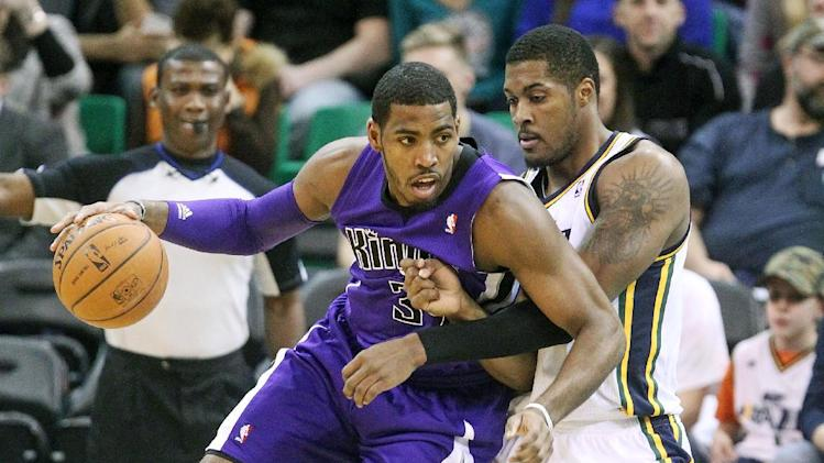Favors powers Jazz past depleted Kings, 106-99