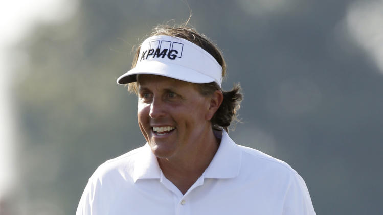 Phil Mickelson smiles as he finishes his second round at the Cadillac Championship golf tournament on Friday, March 8, 2013, in Doral, Fla. (AP Photo/Wilfredo Lee)
