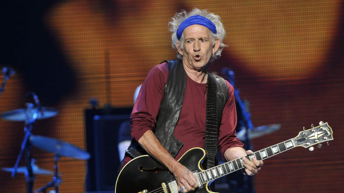 """Keith Richards of the Rolling Stones performs on the kick-off of the band's """"50 and Counting"""" tour at the Staples Center on Friday, May 3, 2013 in Los Angeles. (Photo by Chris Pizzello/Invision/AP)"""