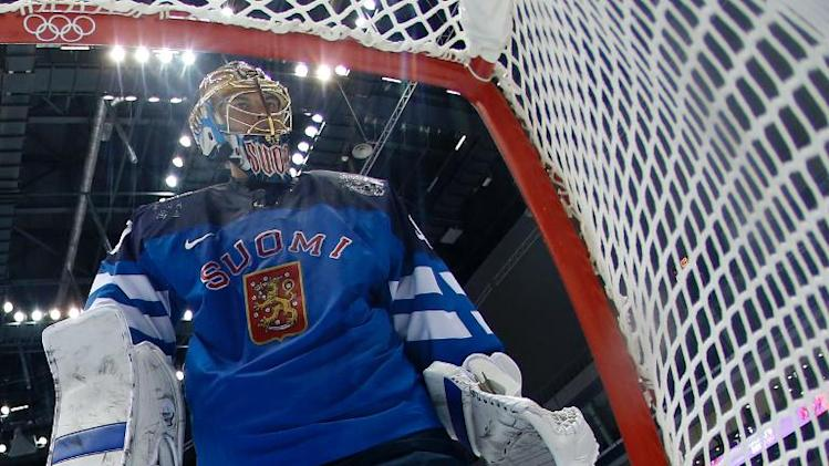 Finland's goalkeeper Tuukka Rask skates in front of his net during the Men's Ice Hockey Quarterfinals Finland vs Russia at the Bolshoy Ice Dome during the Sochi Winter Olympics on February 19, 2014
