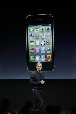 Apple CEO Tim Cook talks about the iPhone 4S during an announcement at Apple headquarters in Cupertino, Calif., Tuesday, Oct. 4, 2011.  (AP Photo/Paul Sakuma)