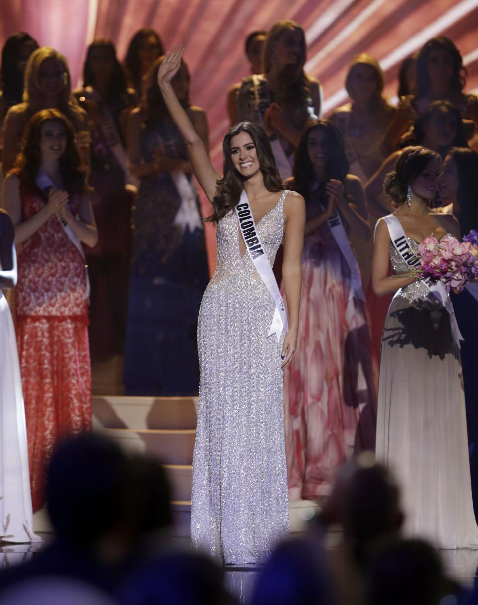 Miss Colombia Paulina Vega waves after becoming  Miss Universe at the Miss Universe pageant in Miami, Sunday, Jan. 25, 2015. (AP Photo/Wilfredo Lee)