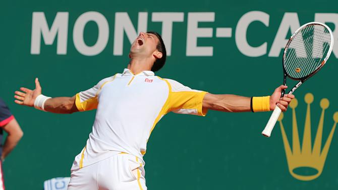 Novak Djokovic of Serbia reacts after defeating Spain's Rafael Nadal, during their final match of the Monte Carlo Tennis Masters tournament in Monaco, Sunday, April 21, 2013. (AP Photo/Claude Paris)