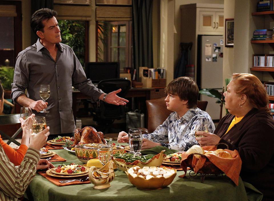 "In this undated publicity image released by CBS, from left, Charlie Sheen, Angus T. Jones and Conchata Ferrell are shown during the taping of ""Two and a Half Men,"" in Los Angeles. (AP Photo/CBS, Greg Gayne)"