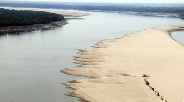 A lowering river allows the sand bars to emerge in the Mississippi River near Greenville, Miss.,Tuesday, Aug. 21, 2012. Officials with the U.S. Army Corps of Engineers say low water levels that are re