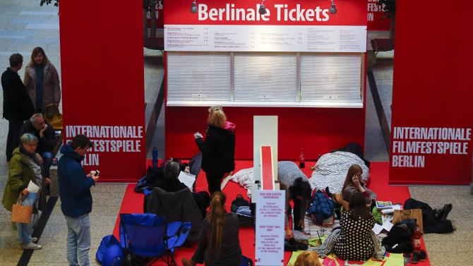 People queue to buy tickets for the upcoming 66th Berlinale International Film Festival in Berlin
