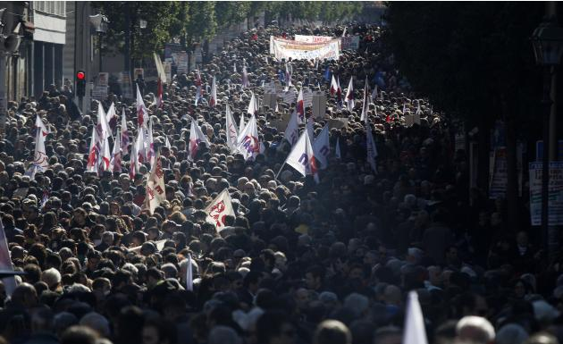 Members of pro-communist union PAME gather during a protest in Athens, Wednesday, Feb. 20, 2013. Thousands of anti-austerity demonstrators took to the streets of Athens on Wednesday as unions staged a