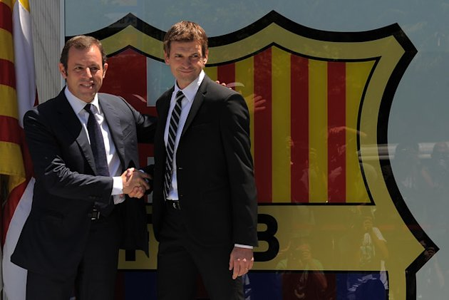Barcelona's New Coach Tito Vilanova (R) Shakes AFP/Getty Images