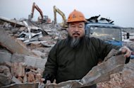Chinese artist Ai Weiwei, pictured in 2011 outside his demolished studio, is unlikely to win a multi-million-dollar tax case that was filed against a company he founded when a court announces a verdict Friday, the activist&#39;s lawyer said