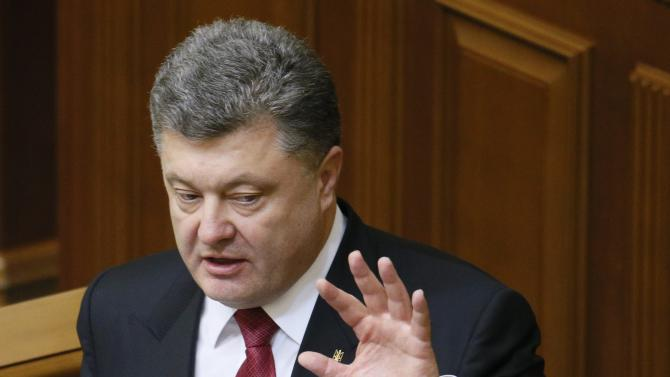 Ukraine's President Poroshenko delivers a speech during a session of the parliament in Kiev