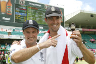CORRECTS SPELLING OF URN - England's cricket captain Andrew Strauss, right, holds the Ashes urn with Kevin Pietersen after winning the 5th Ashes Test Match and the series in Sydney, Australia, Friday, Jan. 7, 2011.