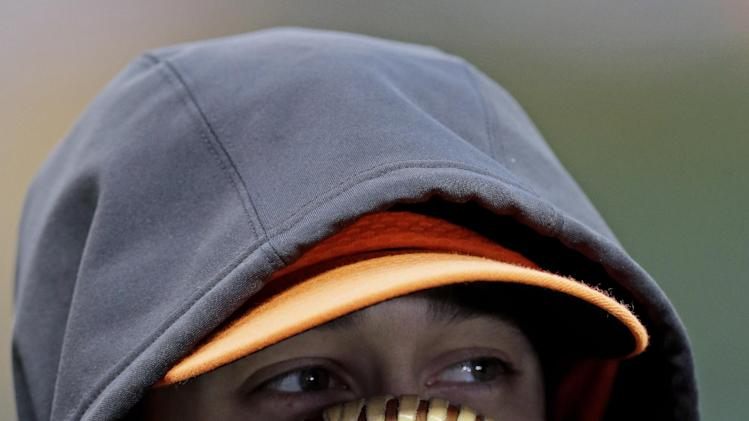 San Francisco Giants pitcher Tim Lincecum tries to stay warm Game 4 of baseball's World Series against the Detroit Tigers Sunday, Oct. 28, 2012, in Detroit. (AP Photo/Patrick Semansky)