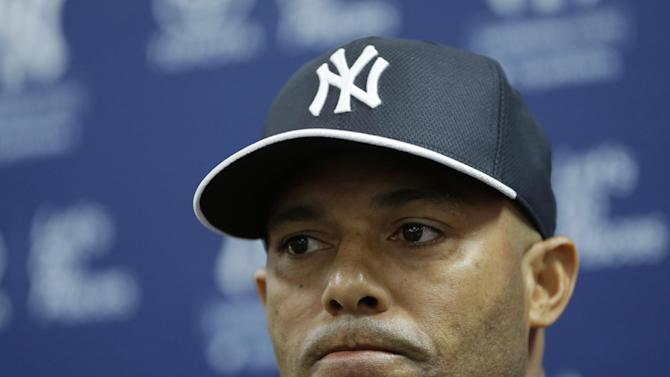 New York Yankees pitcher Mariano Rivera, who holds baseball's all-time saves record, announces his plans to retire at the end of the 2013 season during a news conference at Steinbrenner Field Saturday, March 9, 2013 in Tampa, Fla. (AP Photo/Kathy Willens)