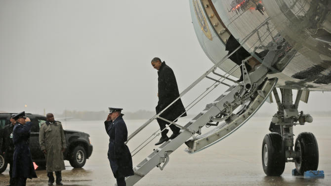 President Barack Obama steps off Air Force One upon his arrival at Andrews Air Force Base, Md., Monday, Oct. 29, 2012. The president flew back from Florida after canceling a morning campaign rally in Orlando to return to Washington to monitor the preparation for early response to Hurricane Sandy. (AP Photo/Pablo Martinez Monsivais)