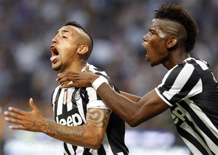 Juventus' Vidal celebrates after scoring against Inter Milan during their Italian Serie A soccer match in Milan