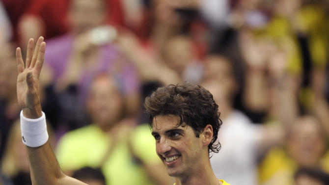 Brazil's Thomaz Bellucci waves to the crowd after beating the USA's John Isner in the 2013 World Group First Round of the Davis Cup Sunday Feb. 3, 2013 at Veterans Memorial Arena in Jacksonville, Fla. (AP Photo/The Florida Times-Union, Will Dickey)