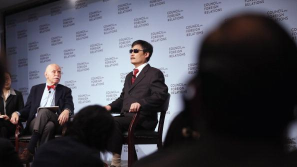 Chinese activist Chen Guancheng (R) speaks as Jerome Cohen (L), adjunct senior fellow for Asia studies at the Council on Foreign Relations, looks on at the Council on Foreign Relations on May 31, 2012 in New York City. This was Chen's first major public engagement since he escaped confinement and left China nearly two weeks ago. (Photo by Mario Tama/Getty Images)